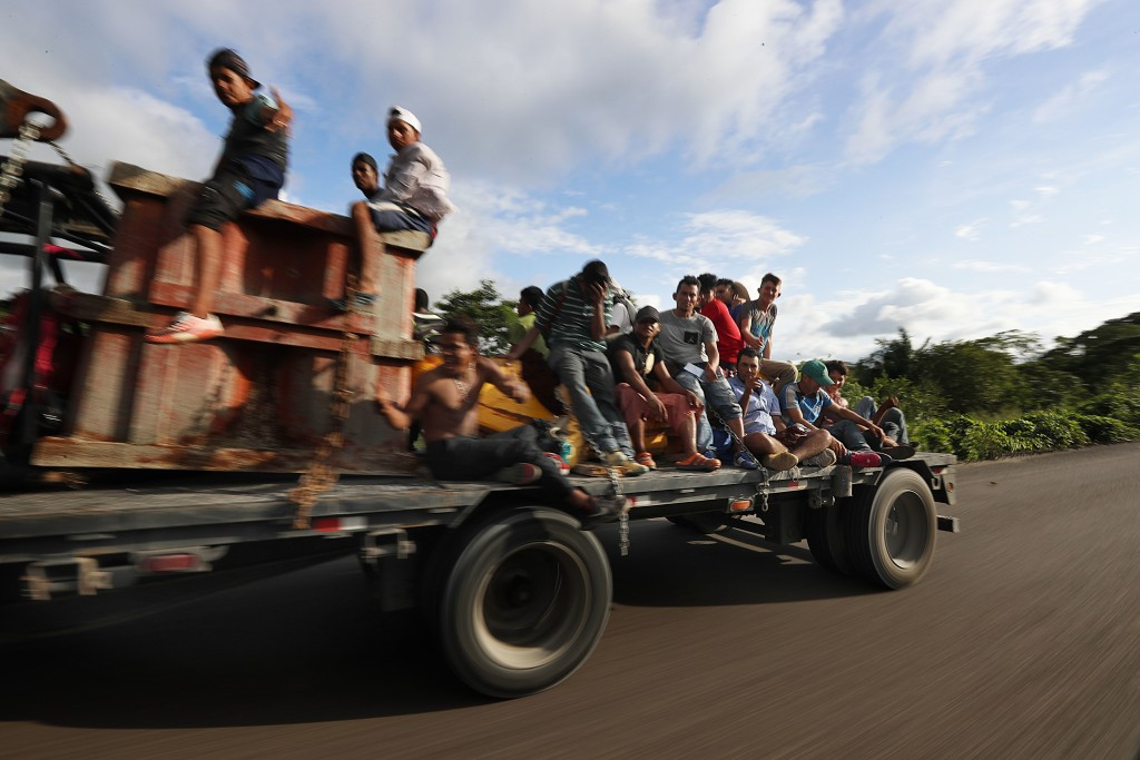 Central American migrants, part of the caravan hoping to reach the U.S. border, get a ride on a truck, in Donaji, Oaxaca state, Mexico, Friday, Nov. 2