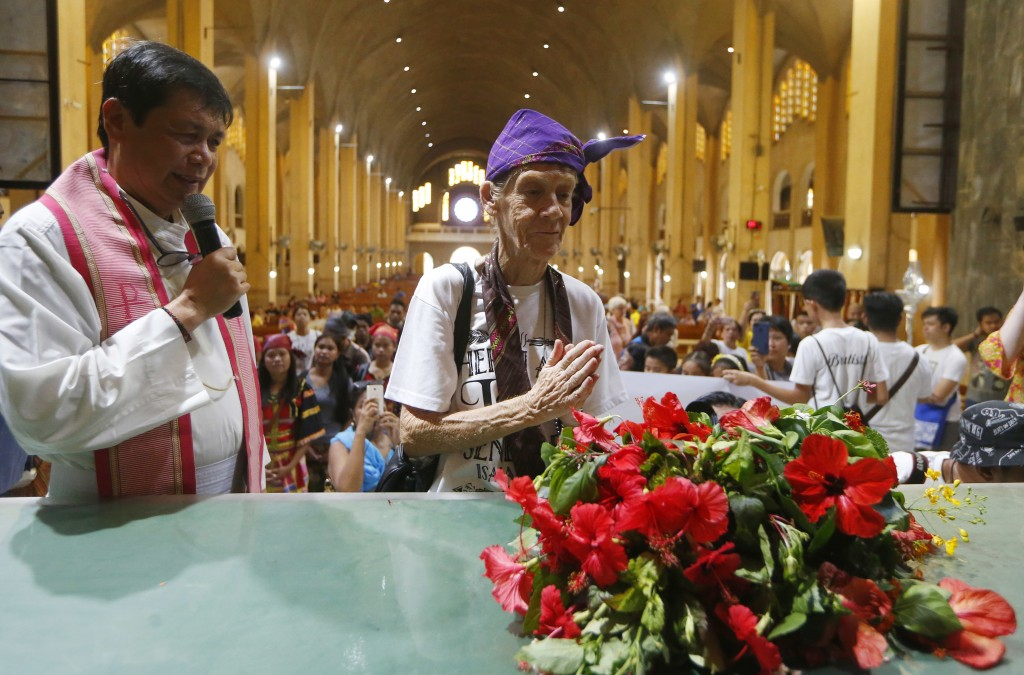 Australian Roman Catholic nun Sister Patricia Fox prays briefly after offering flowers to the image of Our Lady of Perpetual Help during her visit to