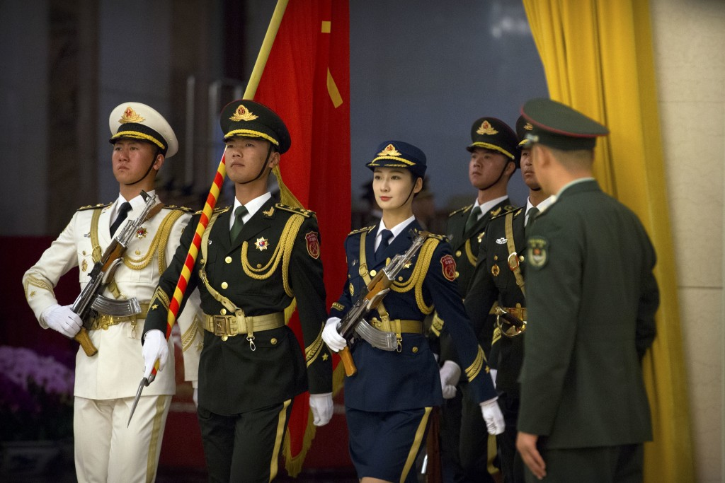 Members of an honor guard march in formation before a welcome ceremony for Pakistan's Prime Minister Imran Khan at the Great Hall of the People in Bei...