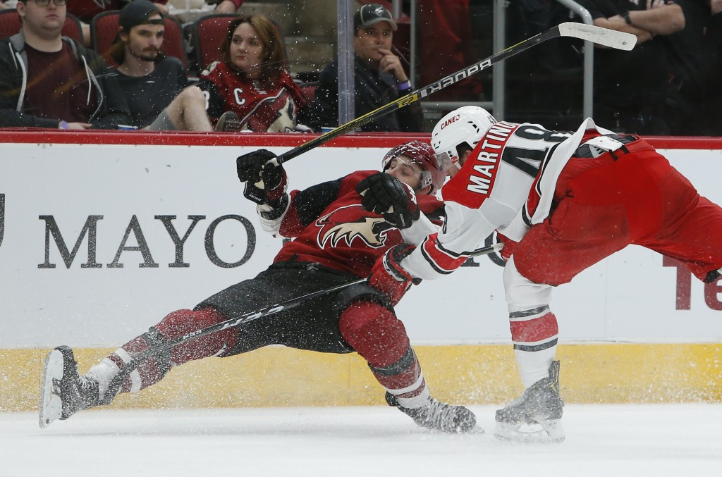 Carolina Hurricanes left wing Jordan Martinook (48) drags down Arizona Coyotes center Alex Galchenyuk for a tripping penalty during the first period o...