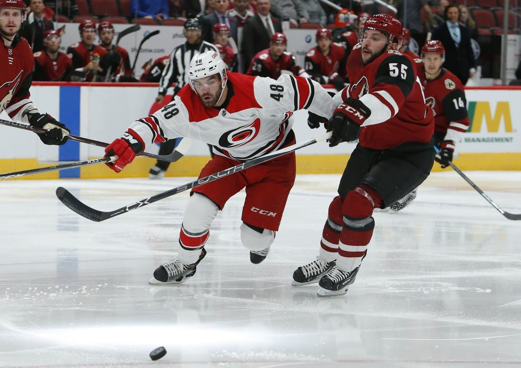 Carolina Hurricanes left wing Jordan Martinook (48) battles for the puck with Arizona Coyotes defenseman Jason Demers during the first period of an NH