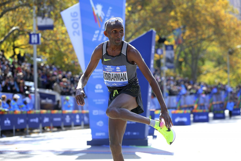 FILE - In this Nov. 6, 2016, file photo, Abdi Abdirahman, of the United States, reacts after crossing the finish line for third place in the men's div...