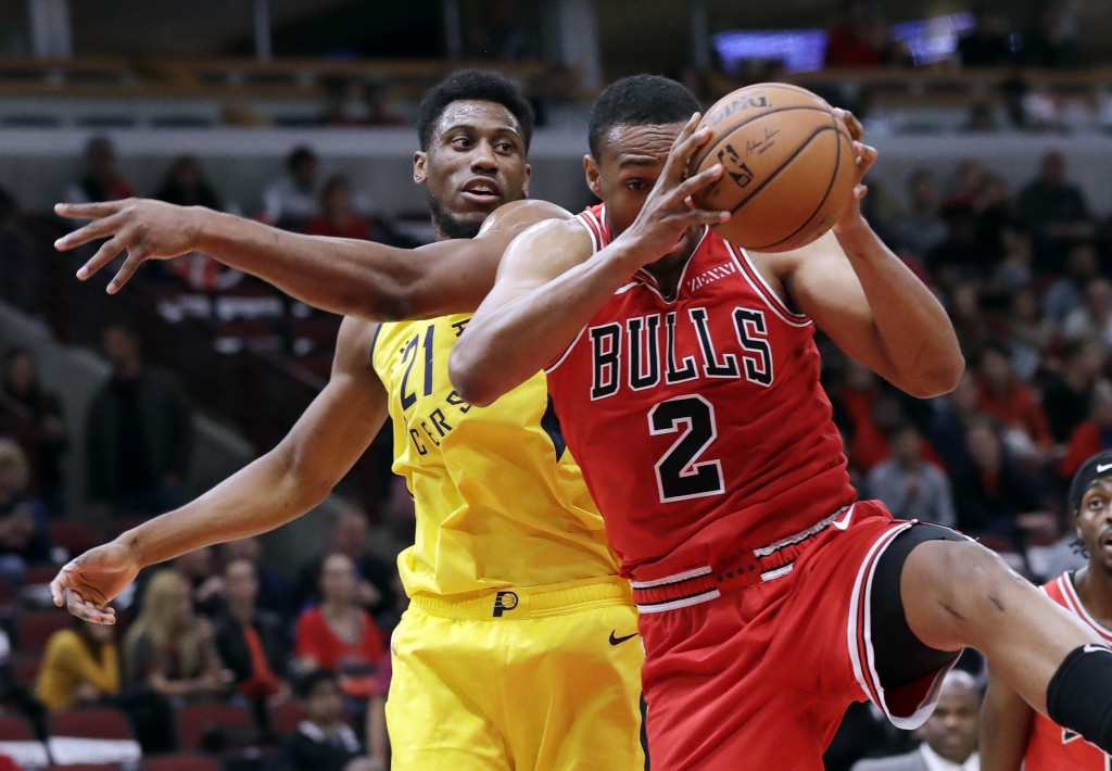 Chicago Bulls forward Jabari Parker, right, rebounds the ball against Indiana Pacers forward Thaddeus Young during the first half of an NBA basketball...