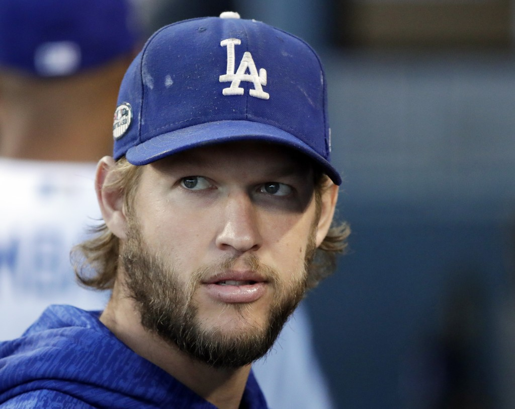 FILE - In this Oct. 16, 2018 file photo, Los Angeles Dodgers pitcher Clayton Kershaw watches before Game 4 of the National League Championship Series
