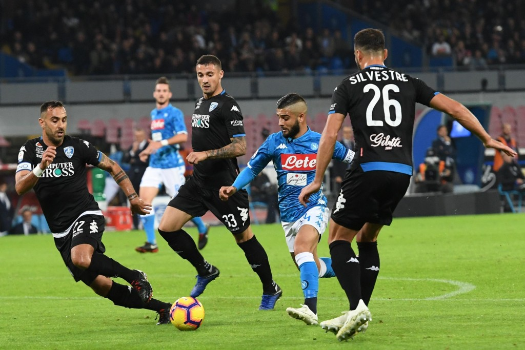 Napoli's forward Lorenzo Insigne, second from right, scores his side's first goal during the Italian Serie A soccer match between Napoli and Empoli at