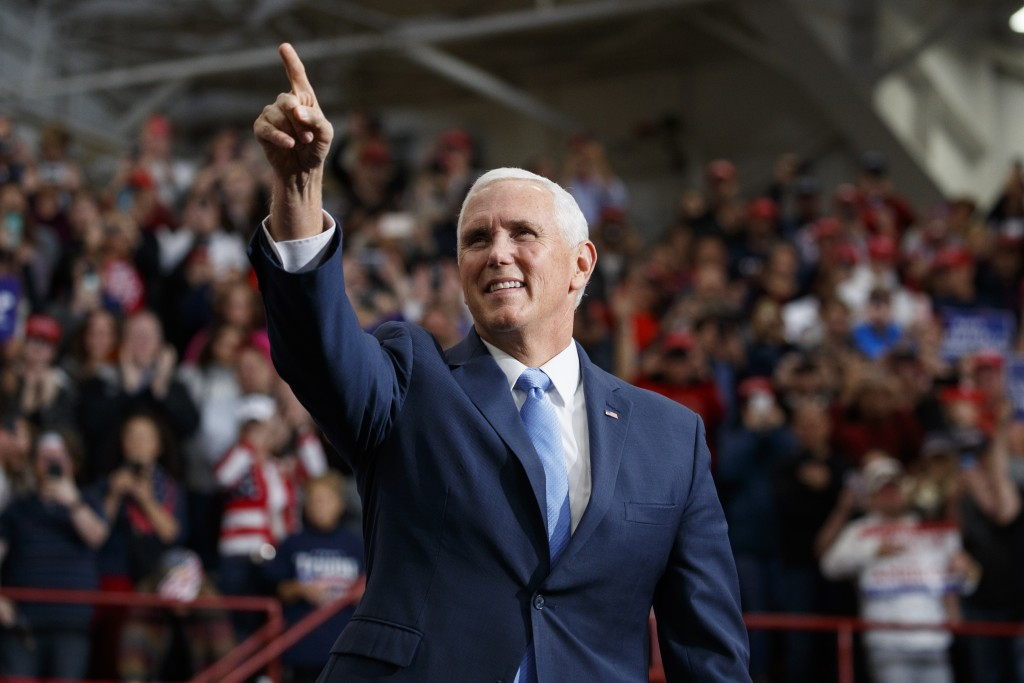 Vice President Mike Pence arrives for a campaign rally with President Donald Trump at Southport High School, Friday, Nov. 2, 2018, in Indianapolis. (A...