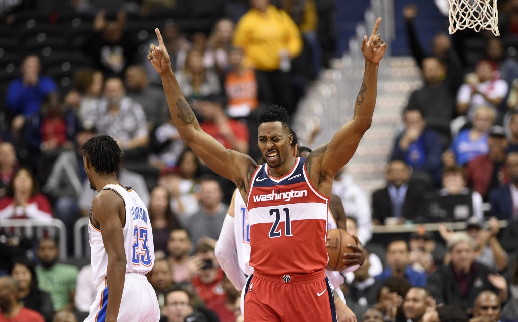 Washington Wizards center Dwight Howard (21) gestures after he dunked and was fouled during the first half of an NBA basketball game, as Oklahoma City...