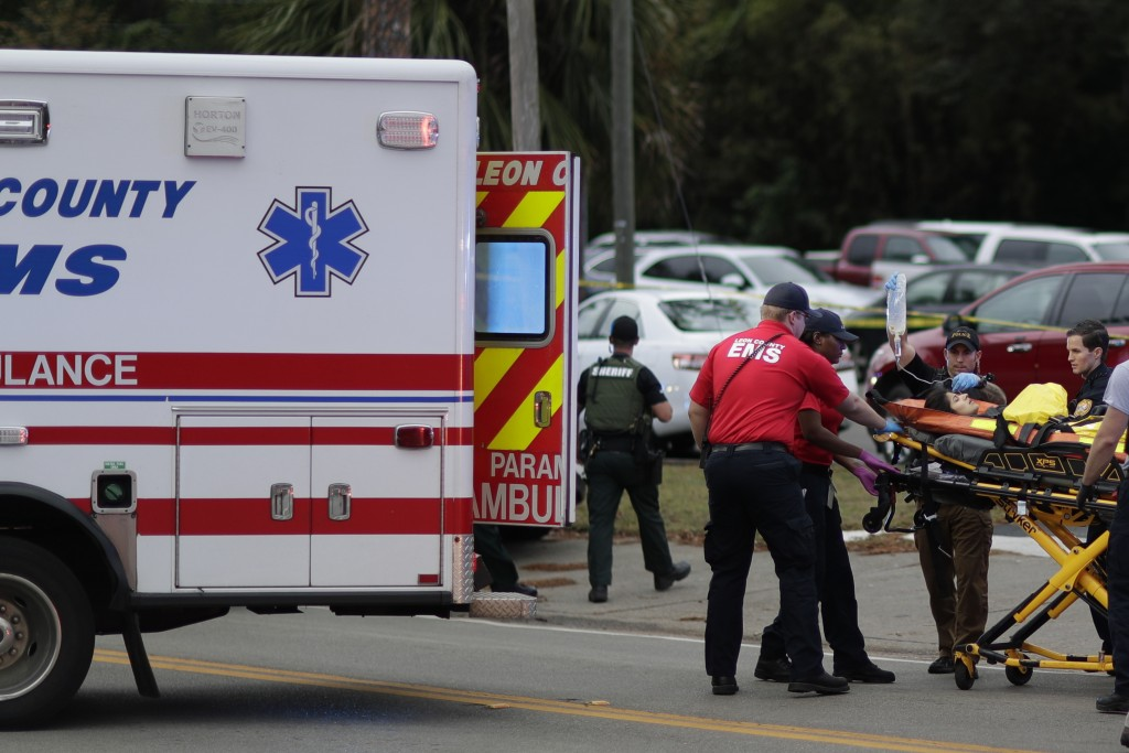 A person is transported from scene of a shooting, Friday, Nov. 2, 2018, in Tallahassee, Fla. A shooter killed one person and critically wounded four o...