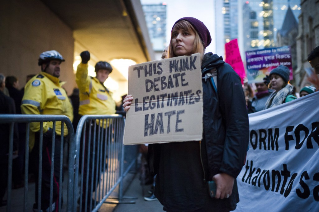 Protesters demonstrate outside a Toronto Munk debate featuring Steve Bannon and conservative commentator David Frum in Toronto on Friday, Nov. 2, 2018