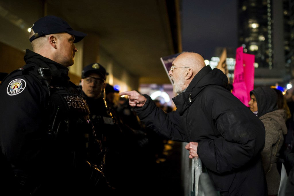 Police and protesters clash prior to a Toronto Munk debate featuring former White House chief strategist Steve Bannon and conservative commentator Dav...