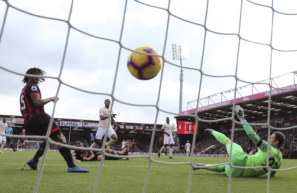 Manchester United's Anthony Martial scores his side's first goal of the game during the English Premier League soccer match between Bournemouth and Ma...