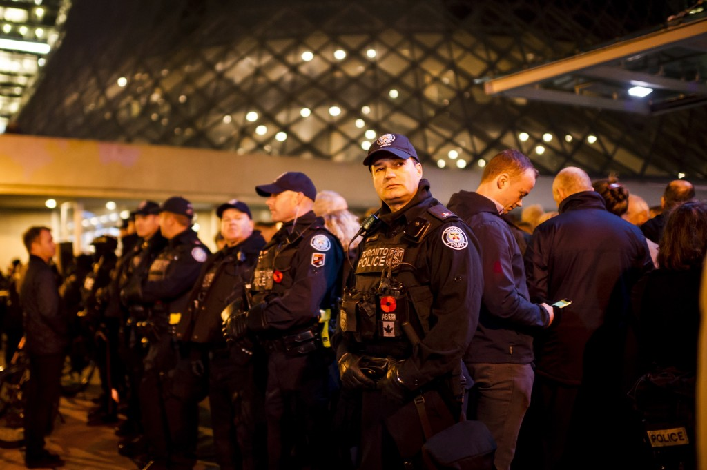Police protect a line-up of guests to a Toronto Munk debate featuring former White House chief strategist Steve Bannon and conservative commentator Da...