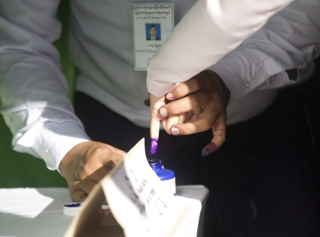 A woman marks her finger with ink indicating she voted as she leaves a polling station in Yangon, Myanmar, Saturday, Nov. 3, 2018. Myanmar staged by-e...