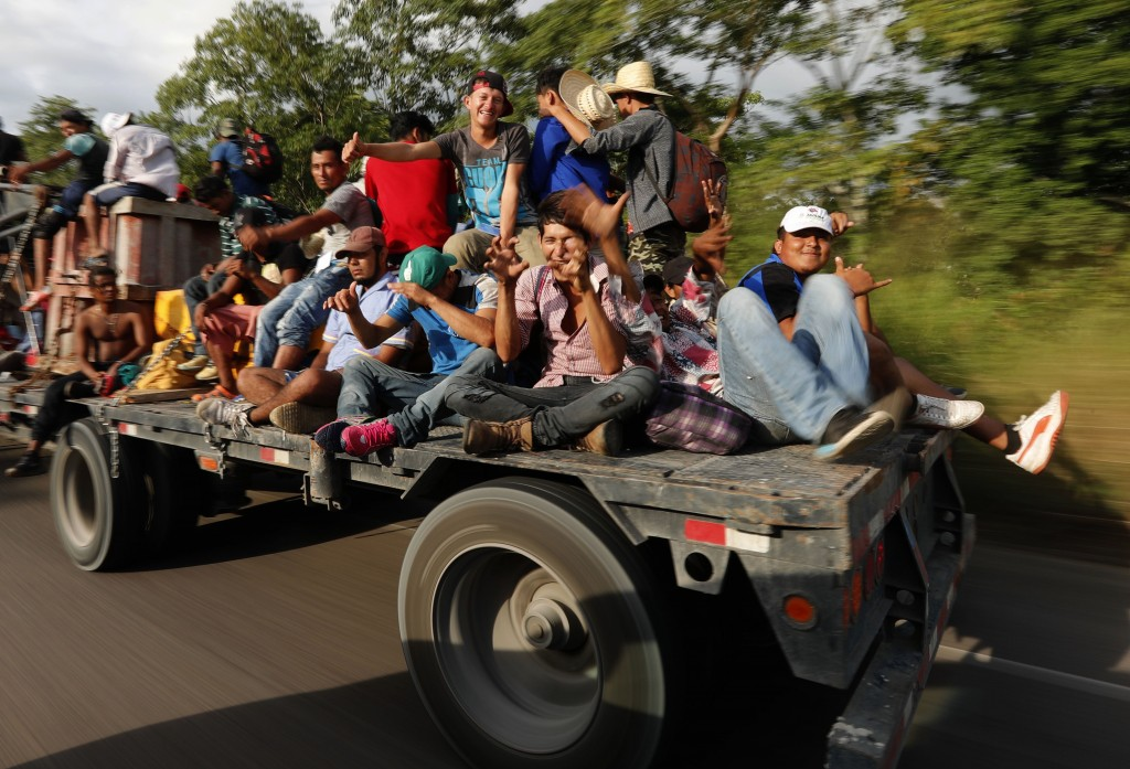 Central American migrants, part of the caravan hoping to reach the U.S. border, get a ride on a truck, in Donaji, Oaxaca state, Mexico, Friday, Nov. 2...