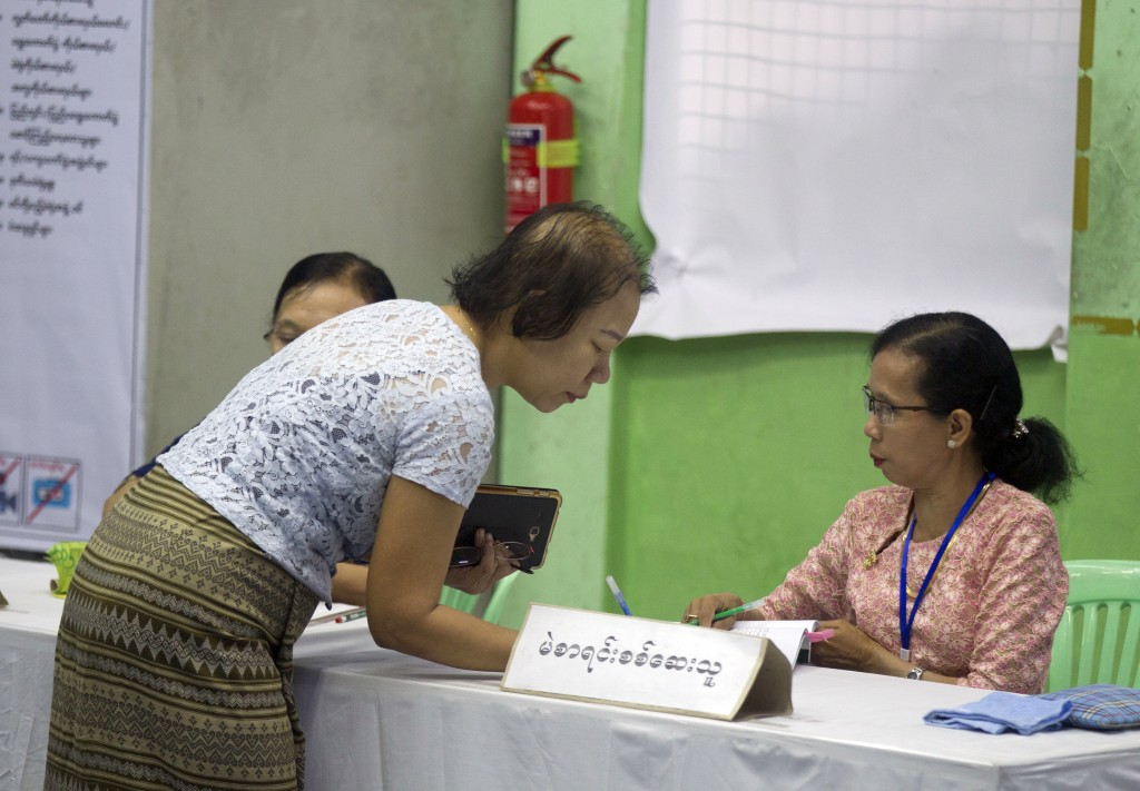 A voter registers to cast her ballot at a polling station in Yangon, Myanmar, Saturday, Nov. 3, 2018. Myanmar staged by-elections Saturday in 13 const