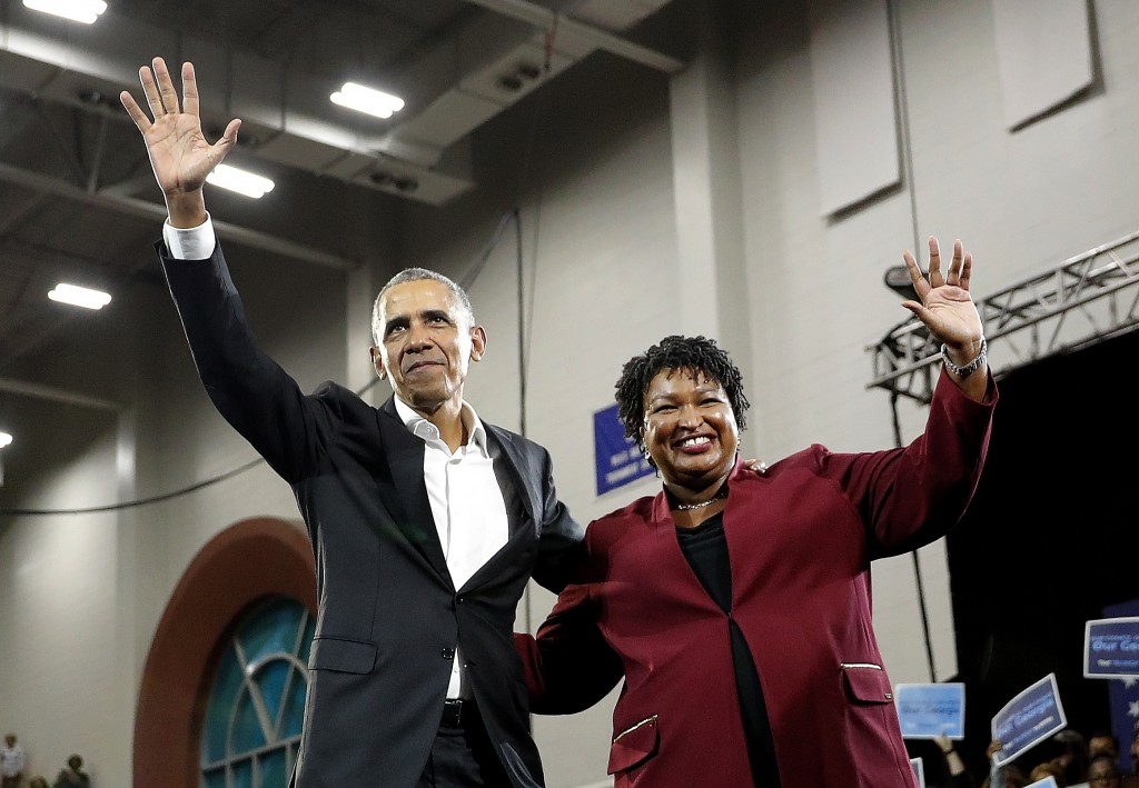 Former President Barack Obama and Democratic candidate for Georgia Goveernor Stacey Abrams wave to the crowd during a campaign rally at Morehouse Coll...