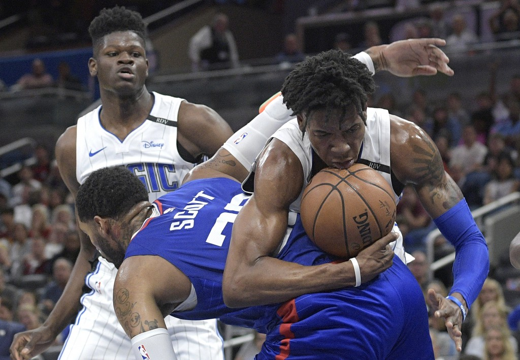 Orlando Magic forward Wesley Iwundu, right, is fouled by Los Angeles Clippers forward Mike Scott (30) after grabbing a rebound as Magic center Mohamed