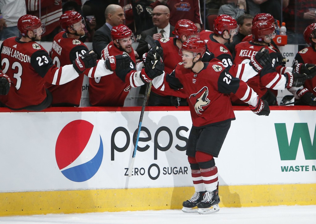Arizona Coyotes center Nick Cousins (25) celebrates with teammates after scoring a goal against the Carolina Hurricanes during the first period of an ...