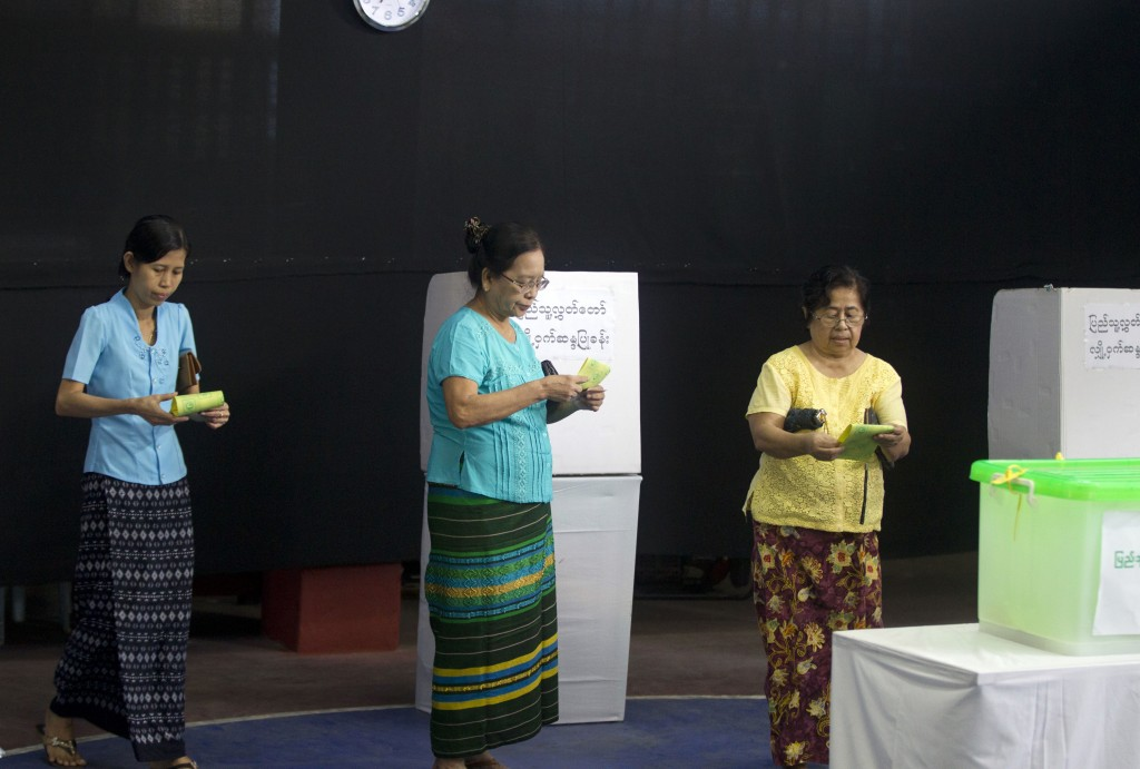 Voters prepare to cast their ballots at a polling station in Yangon, Myanmar, Saturday, Nov. 3, 2018. Myanmar staged by-elections Saturday in 13 const...
