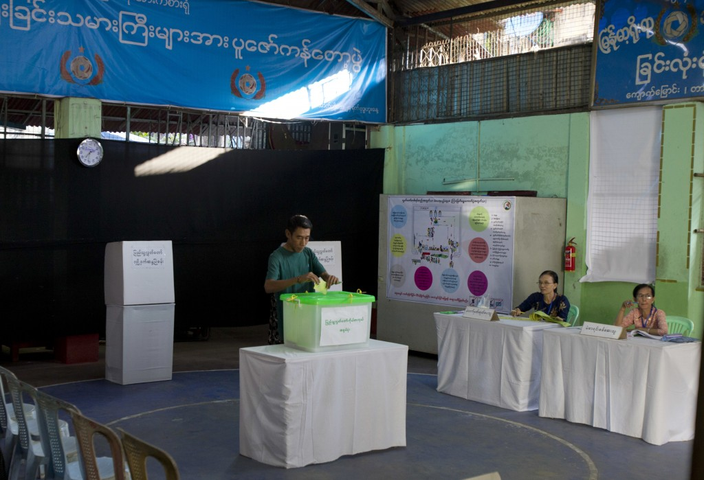 A voter casts his ballot at a polling station in Yangon, Myanmar, Saturday, Nov. 3, 2018. Myanmar staged by-elections Saturday in 13 constituencies, a...