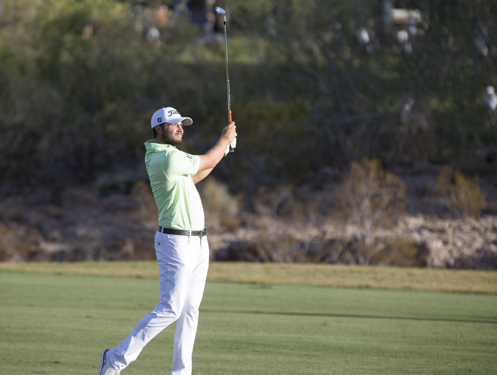 Peter Uihlein watches a shot from the 18th fairway during the second round of the Shriners Hospitals for Children Open golf tournament at TPC at Summe...