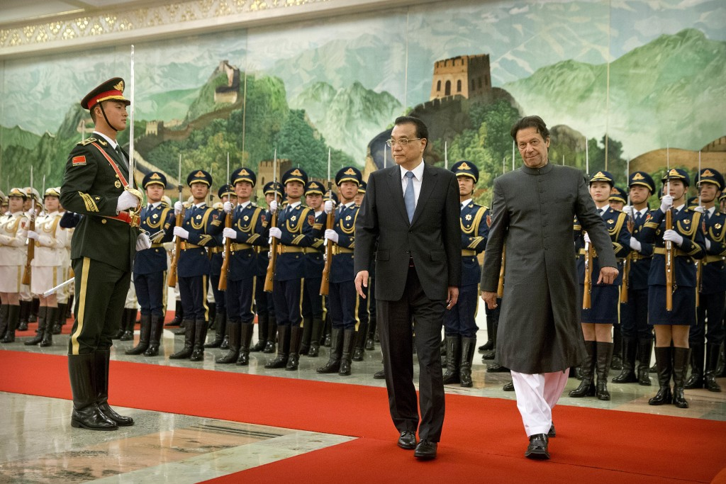 Chinese Premier Li Keqiang, left, and Pakistan's Prime Minister Imran Khan review an honor guard during a welcome ceremony at the Great Hall of the Pe