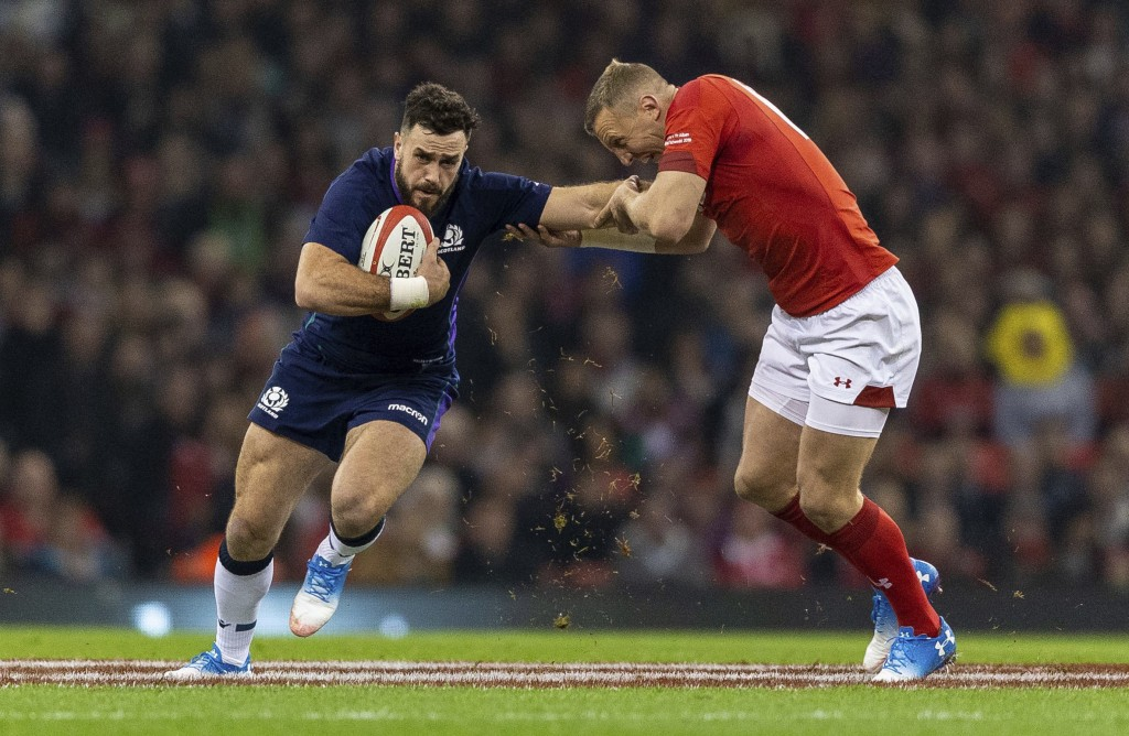 Scotland's Alex Dunbar, left, and Wales' Hadleigh Parkes during the rugby union international match at The Principality Stadium, Cardiff, Wales, Satur