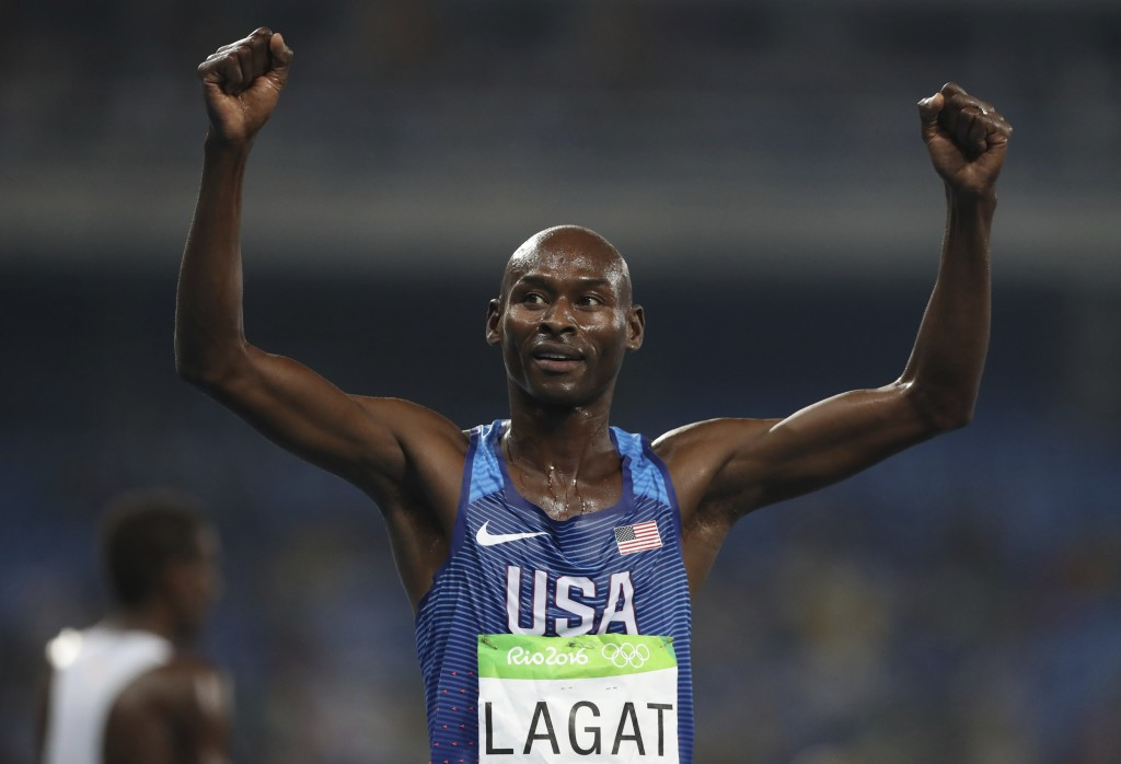 FILE- In this Aug. 20, 2016, file photo, United States' Bernard Lagat celebrates finishing the men's 5000-meter race during the athletics competition ...