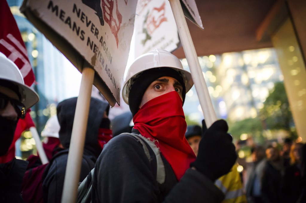Protesters demonstrate prior to a Toronto Munk debate featuring former White House strategist Steve Bannon and conservative commentator David Frum in ...