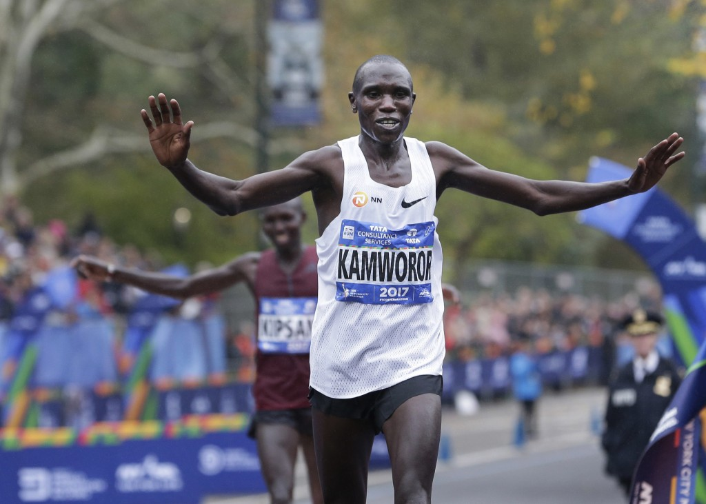 FILE - In this Nov. 5, 2017, file photo, Geoffrey Kamworor, of Kenya, crosses the finish line first to win the men's division of the New York City Mar...