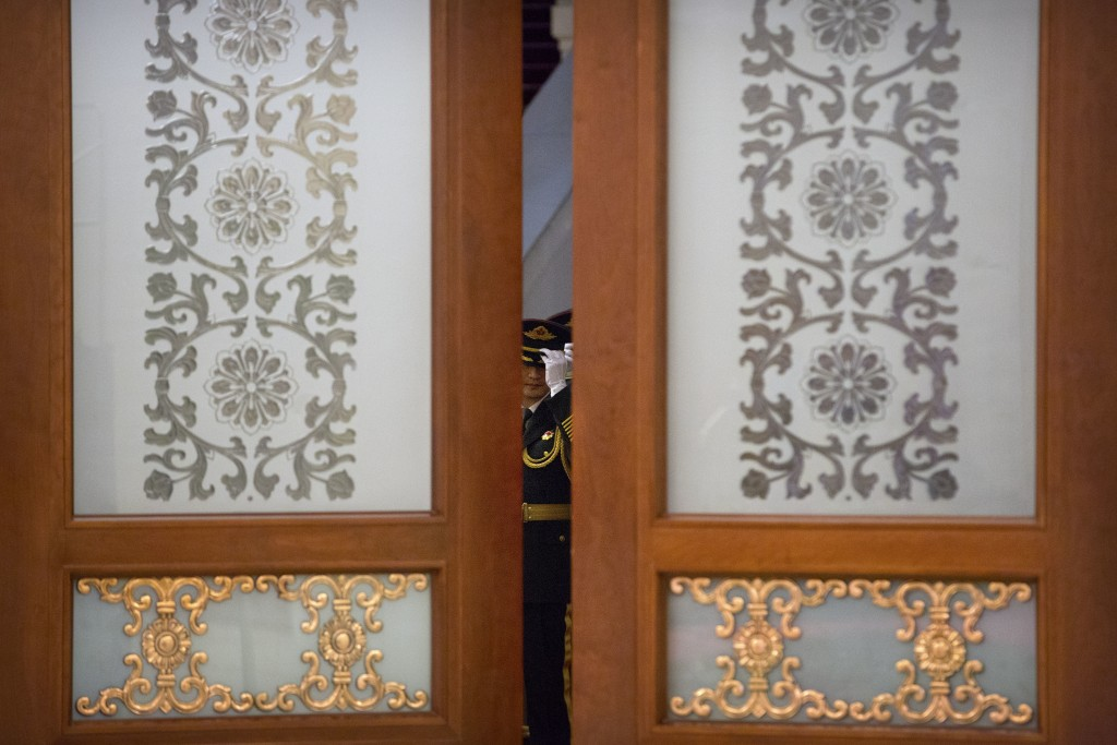 A member of an honor guard adjusts his hat before a welcome ceremony for Pakistan's Prime Minister Imran Khan at the Great Hall of the People in Beiji...