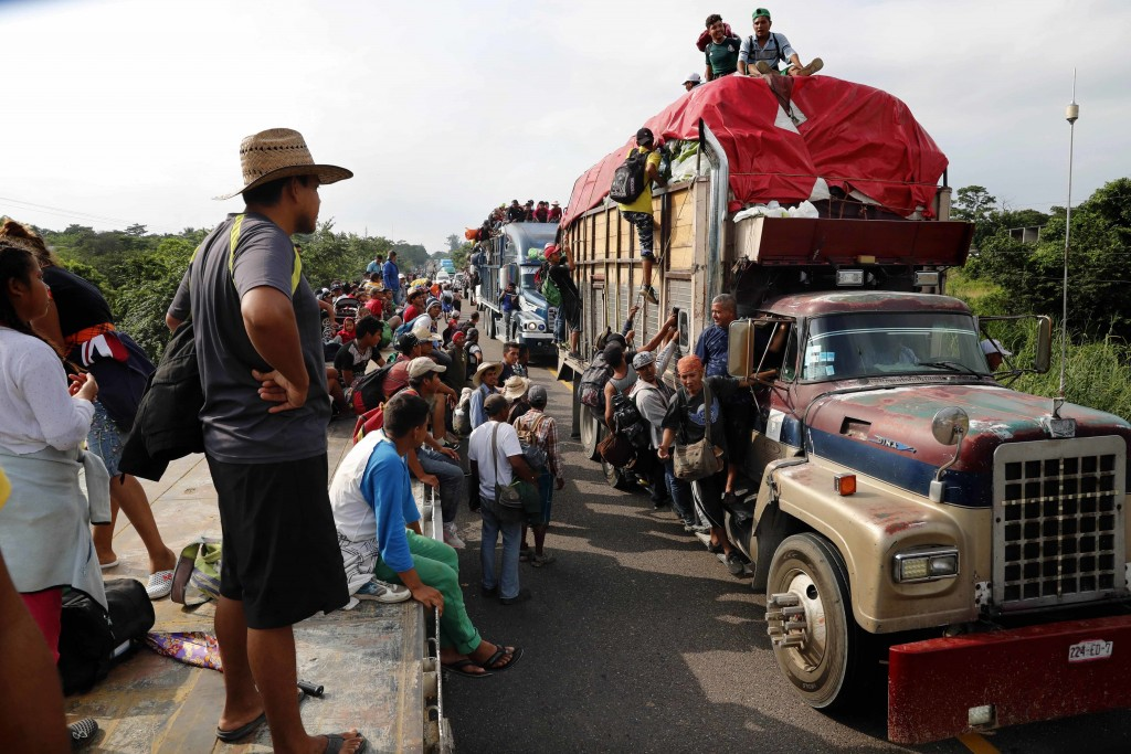 Central American migrants, part of the caravan hoping to reach the U.S. border, get a ride on trucks, in Donaji, Oaxaca state, Mexico, Friday, Nov. 2,...