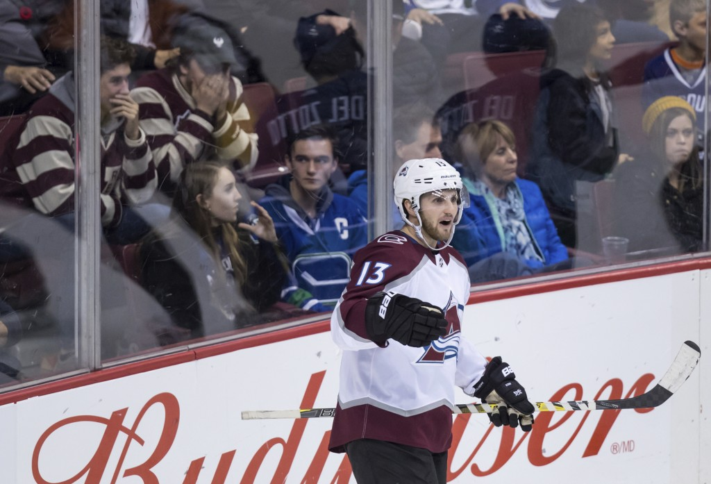 Colorado Avalanche center Alexander Kerfoot (13) celebrates his goal against the Vancouver Canucks during the second period of an NHL hockey game Frid