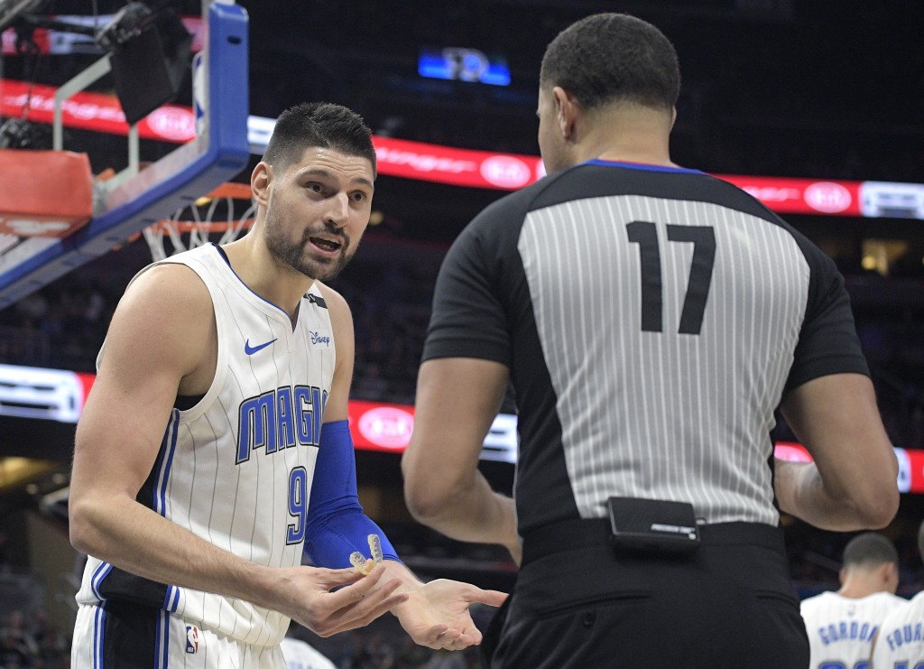 Orlando Magic center Nikola Vucevic (9) argues a call with official Jonathan Sterling (17) during the first half of the team's NBA basketball game aga...