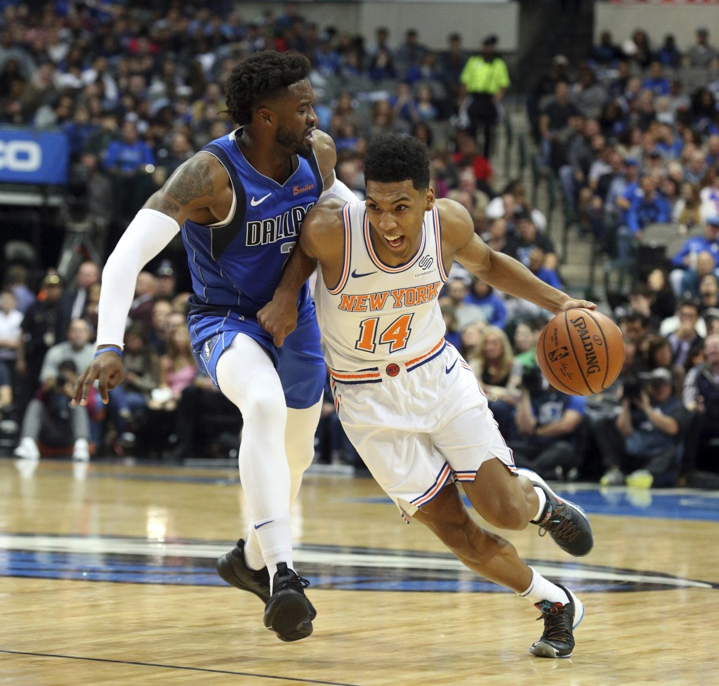 Dallas Mavericks guard Wesley Matthews, left, defends as New York Knicks guard Allonzo Trier (14) tries to drive the ball past him in the first half o