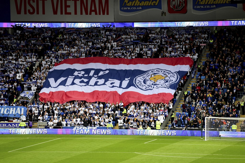 Leicester City fans with a giant banner that reads 'RIP Vichai' during the English Premier League soccer match between Cardiff City and Leicester City...