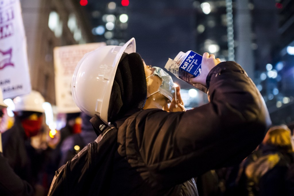Protesters treat their eyes after police use pepper spray on demonstrators outside a Toronto Munk debate featuring former White House chief strategist...