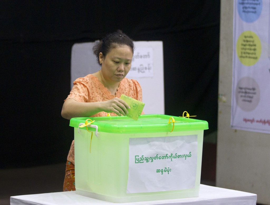 A voter casts her ballot at a polling station in Yangon, Myanmar, Saturday, Nov. 3, 2018. Myanmar staged by-elections Saturday in 13 constituencies, a