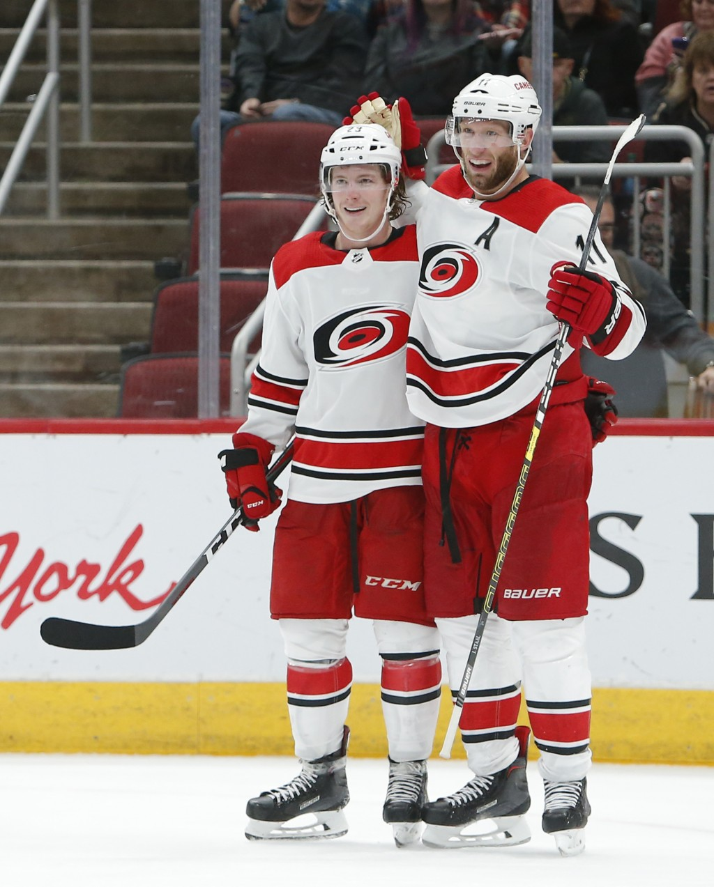 Carolina Hurricanes center Jordan Staal (11) celebrates with Brock McGinn after scoring a goal during the third period of an NHL hockey game against t...