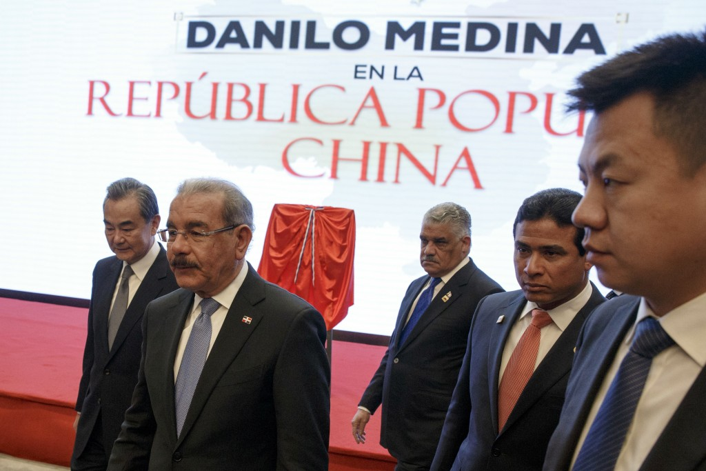 China's Foreign Minister Wang Yi, left, and Dominican Republic's President Danilo Medina, second left, attend the opening ceremony of Dominican Republ...