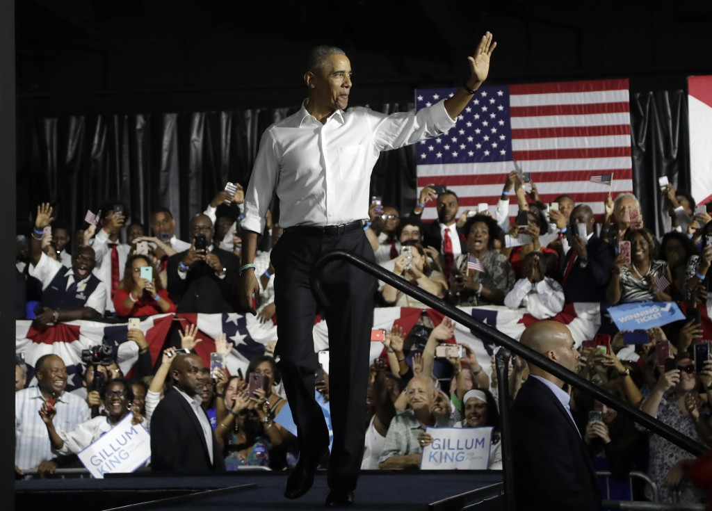 Former President Barack Obama arrives for a campaign rally in support of Democratic candidates, Friday, Nov. 2, 2018, in Miami. (AP Photo/Lynne Sladky...