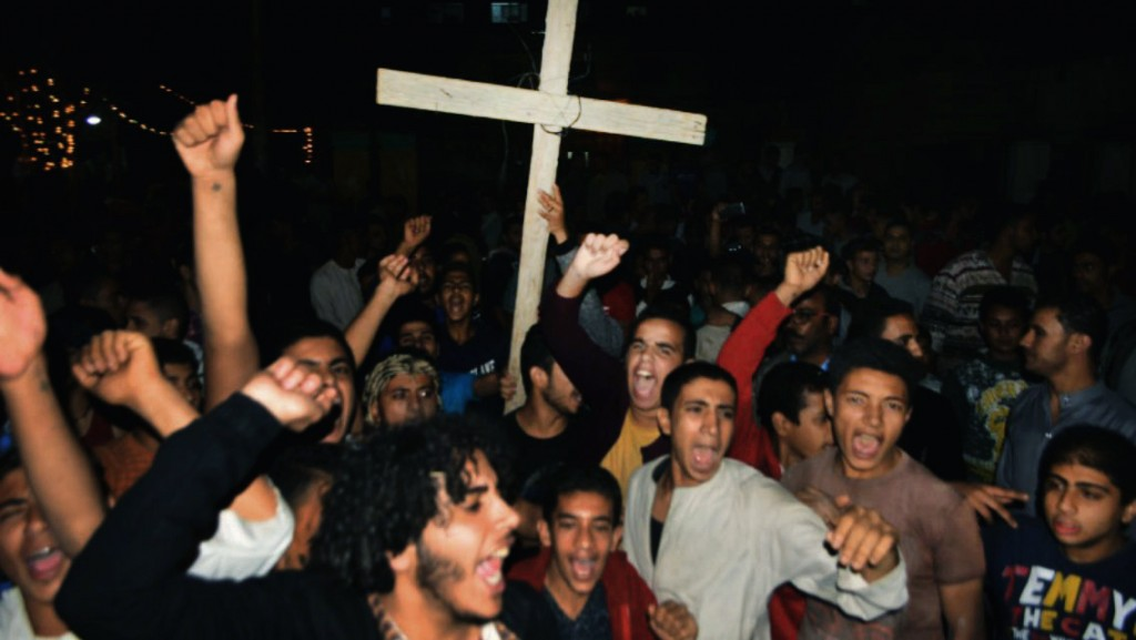 Coptic Christians chant slogans during a protest following an attack on a bus carrying Christian pilgrims on their way to a remote desert monastery, i...
