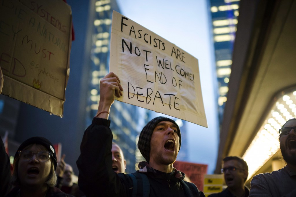 Protesters demonstrate outside a Toronto Munk debate featuring Former White House chief strategist Steve Bannon and conservative commentator David Fru...