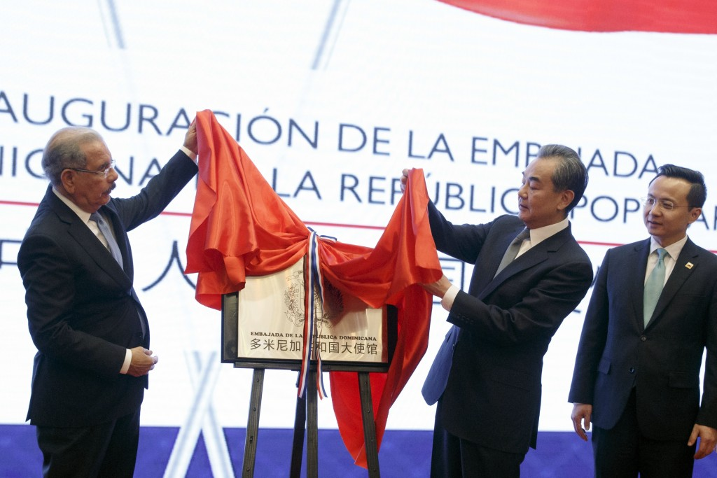 China's Foreign Minister Wang Yi, second right, and Dominican Republic's President Danilo Medina attend the opening ceremony of Dominican Republic emb...