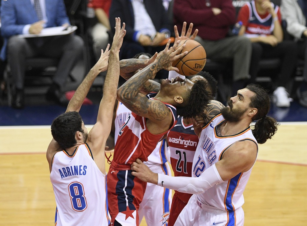 Oklahoma City Thunder center Steven Adams (12), of New Zealand, and guard Alex Abrines (8), of Spain, defend against Washington Wizards forward Kelly ...
