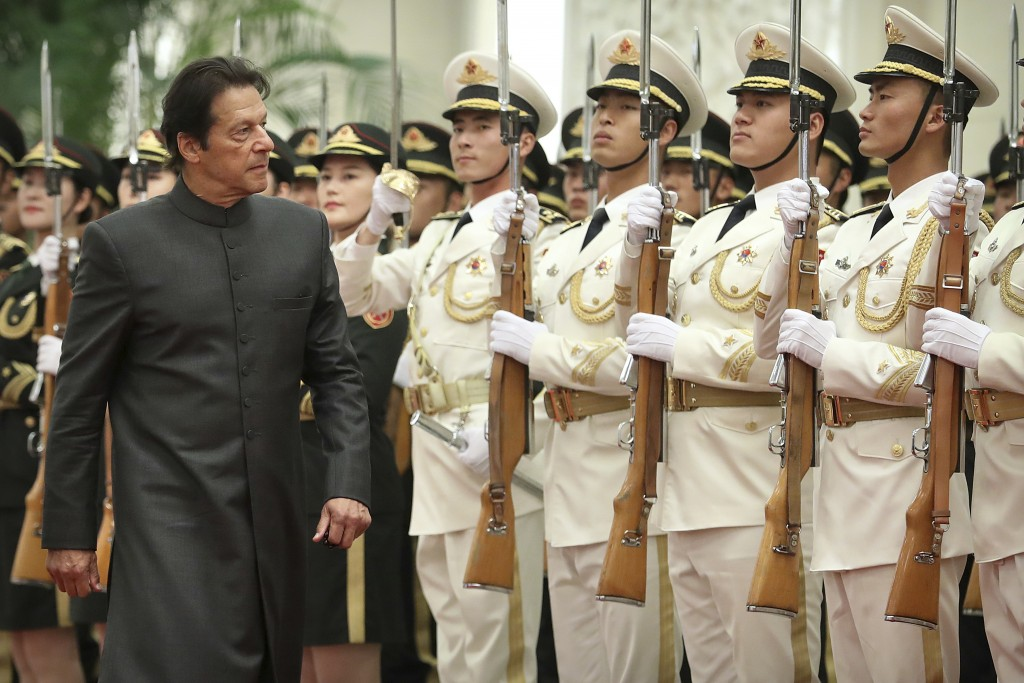 Pakistan's Prime Minister Imran Khan reviews an honor guard during a welcome ceremony at the Great Hall of the People in Beijing, Saturday, Nov. 3, 20...