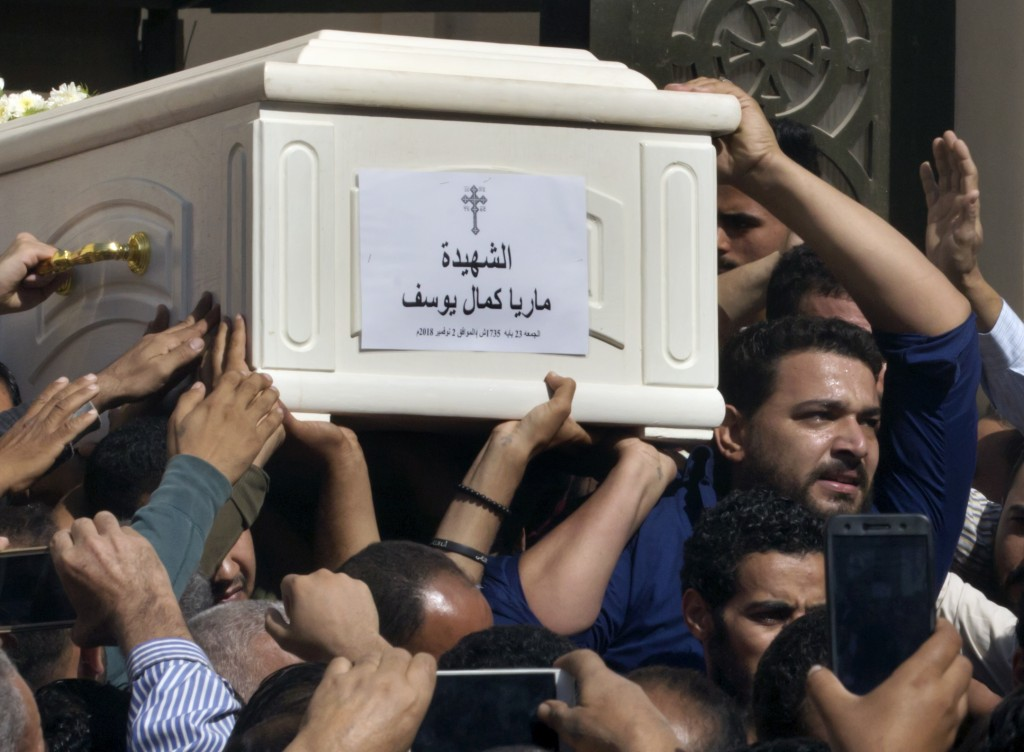Relatives and friends carry the coffin of, Maria Kamal, after funeral service at the Church of Great Martyr Prince Tadros, in Minya, Egypt, Saturday,