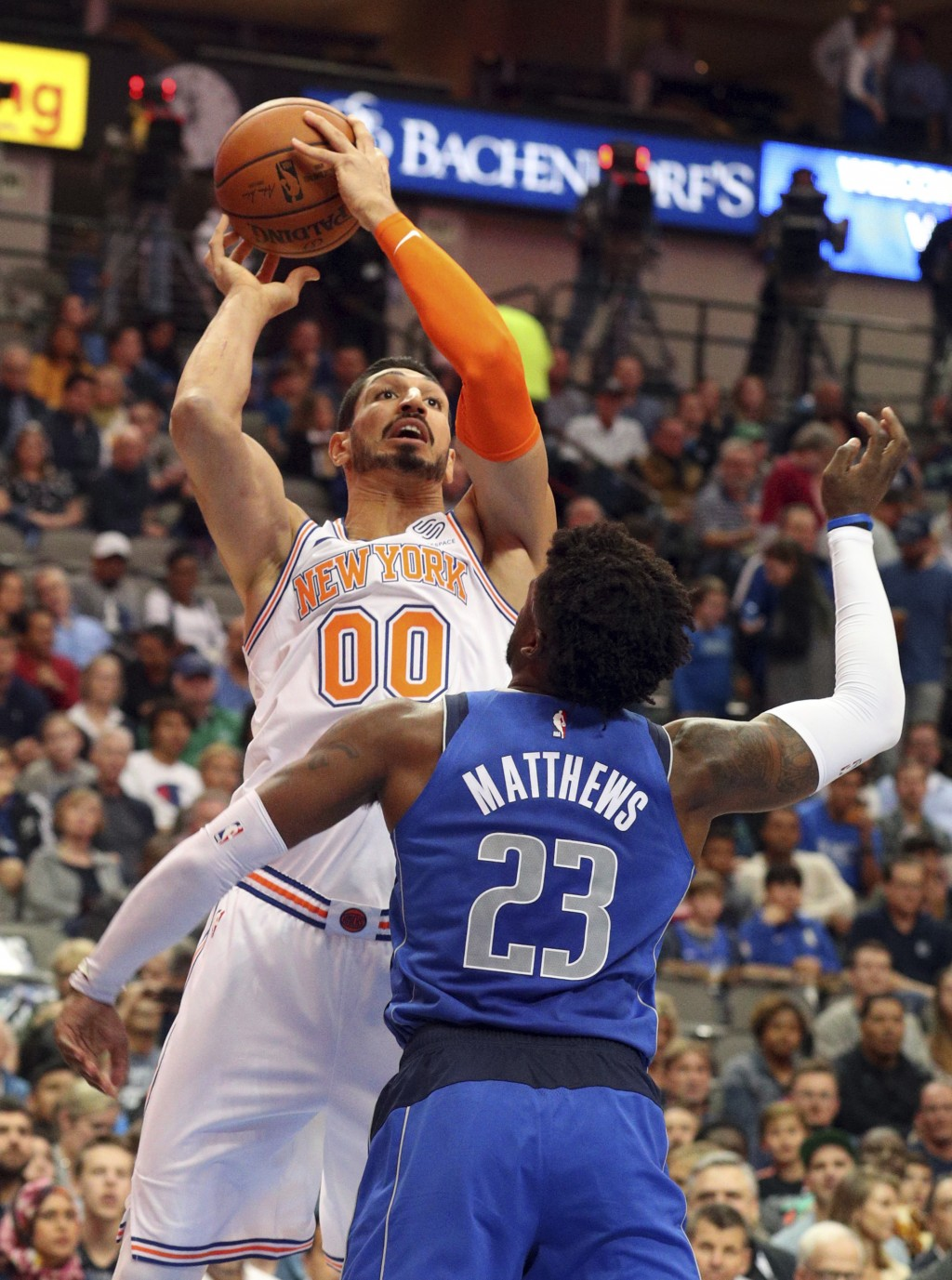 New York Knicks center Enes Kanter (00) shoots over Dallas Mavericks guard Wesley Matthews (23) in the first half of an NBA basketball game Friday, No...