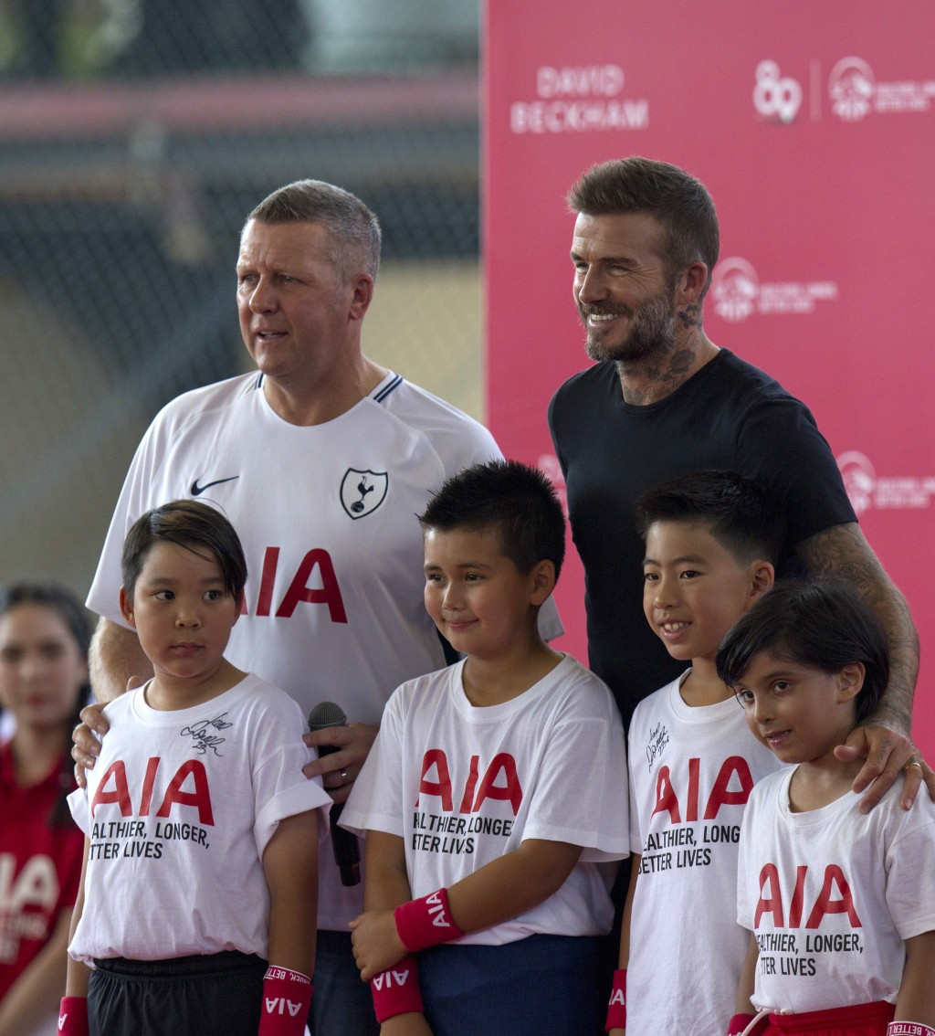 Retired footballer David Beckham, right, poses for a group photograph during a sponsored promotional event in Bangkok, Thailand, Saturday, Nov 3, 2018