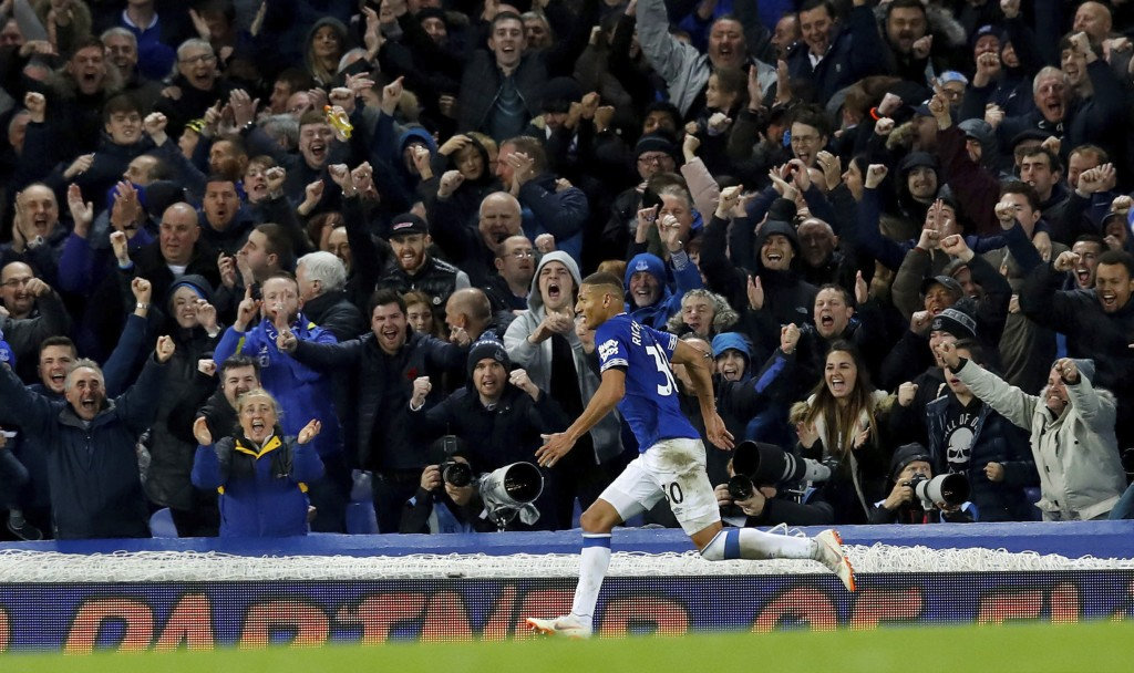 Everton's Richarlison celebrates scoring his side's third goal of the game during the English Premier League soccer match between Everton and Brighton...